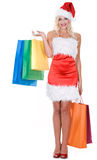 Beauty girl in santa hat with color bag Royalty Free Stock Image