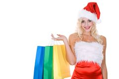 Beauty girl in santa hat with color bag Royalty Free Stock Photo