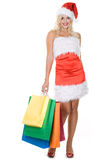 Beauty girl in santa hat with color bag Royalty Free Stock Photos