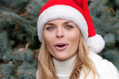 Beauty girl in santa red cap Royalty Free Stock Images