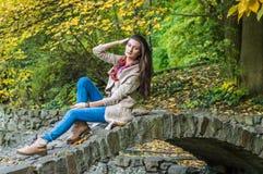 Beauty girl sitting on bridge Royalty Free Stock Photos