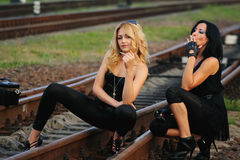 Beauty girl sitting on the railroad track Stock Photos