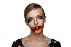Beauty Girl with smeared red Lipstick on open Mouth. Royalty Free Stock Photos