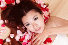 Beauty Girl smiling close-up with rose background Stock Photos