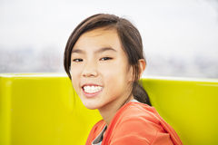 Beauty girl smiling and to look ahead Royalty Free Stock Image