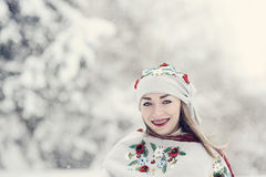 A beauty girl on the snow winter background Stock Photo