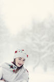 A beauty girl on the snow winter background Stock Photography