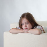 Beauty girl on sofa Royalty Free Stock Image