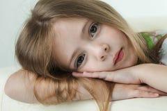 Beauty girl on sofa Stock Photography