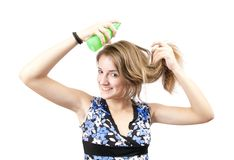 Beauty girl spraying hair Royalty Free Stock Images