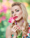 Beauty girl with spring flower on floral Stock Photo