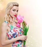 Beauty girl with spring flowers on floral Royalty Free Stock Photo