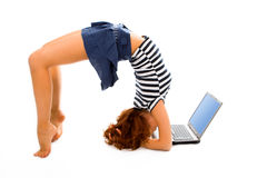 Beauty girl stand on head with laptop
