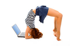 Beauty girl stand on head with laptop stock photos