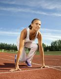 Beauty girl start run. On stadium royalty free stock image