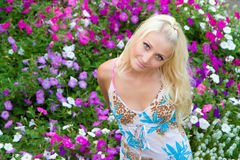 Beauty girl stay in flowers Royalty Free Stock Photography