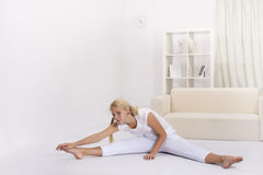 Beauty girl stretching muscles Stock Photography