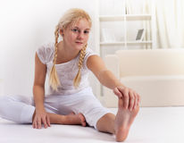 Beauty girl stretching muscles Royalty Free Stock Photography