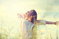 Beauty girl on summer field Royalty Free Stock Images