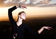 Beauty girl and sunset dances. Beuaty european girl dances on a sunset stock photo