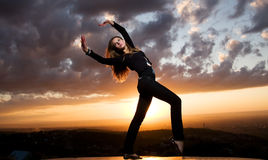 Beauty girl and sunset dances. Beuaty european girl dances on a sunset Royalty Free Stock Photos