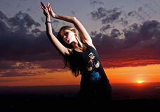 Beauty girl and sunset dances. Beuaty european girl dances on a sunset stock photos