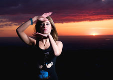 Beauty girl and sunset dances. Beuaty european girl dances on a sunset Stock Photography