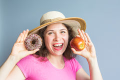 Beauty girl taking colorful donuts. Funny joyful woman with sweets, dessert. Diet, dieting concept. Junk food Royalty Free Stock Image