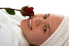 Beauty girl in towel with rose after shower Stock Image