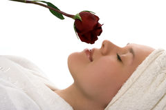 Beauty girl in towel with rose after shower Royalty Free Stock Images