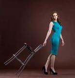 Beauty girl walk with bar chair Stock Image