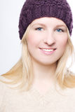 Beauty girl in a warm hat Stock Images