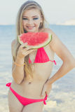 Beauty girl is wearing swimsuit eating watermelon Royalty Free Stock Photography