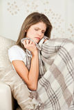 Beauty girl with wool blanket resting in bed Stock Photos