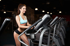 Beauty girl workout exercise on elliptic bike Royalty Free Stock Photos
