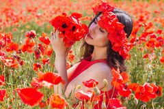 Beauty girl with wreath of poppies flowers Royalty Free Stock Photography