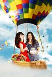 Beauty girls on air balloon in the sky Stock Images