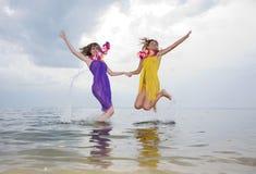 Beauty girls on beach Stock Photos