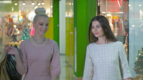 Beauty girls, friends shopping in trade center. Beauty friends shopping in trade center. 4K stock video footage