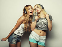 Beauty girls with a microphone singing and dancing Royalty Free Stock Images