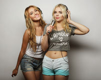 Beauty girls with a microphone singing and dancing Stock Photo