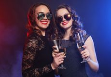 Beauty girls with a microphone singing and dancing. Party time. Beauty girls with wine and  microphone singing and dancing Stock Photo