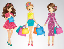 Beauty Girls With Shopping Bags. Vector illustration of beauty girls standing with shopping bags Royalty Free Stock Images