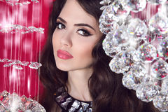 Beauty glam girl portrait. Makeup. Sensual lips. Brunette woman. Over Crystal ball Stock Image