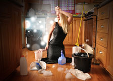 Beauty Glamour Girl Cleaning House. A woman is cleaning the floor acting as a glamourous movie star in an elegant dress for a career or housework concept stock photos