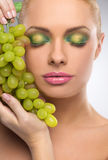 Beauty with grape. Royalty Free Stock Photography
