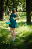 Beauty in green dress Royalty Free Stock Image