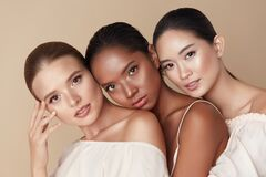 Free Beauty. Group Of Diversity Models Portrait. Multi-Ethnic Women With Different Skin Types Posing On Beige Background. Tender Royalty Free Stock Images - 186544069