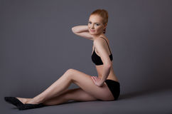 Beauty gymnast girl in black top relax Stock Photos