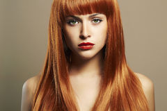 Beauty hair Girl. Healthy Red Hair. Beautiful Young Woman Stock Photo
